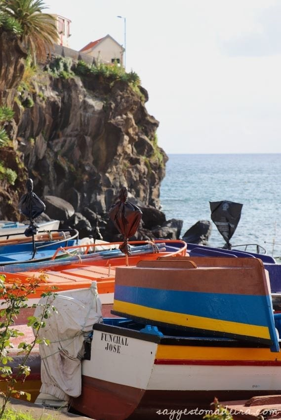 Madeira attractions: What to do in Camara de Lobos. Instagrammable spots in Camara de Lobos. Colorful fishing boats. #madeira #portugal #europetravel #portugaltravel